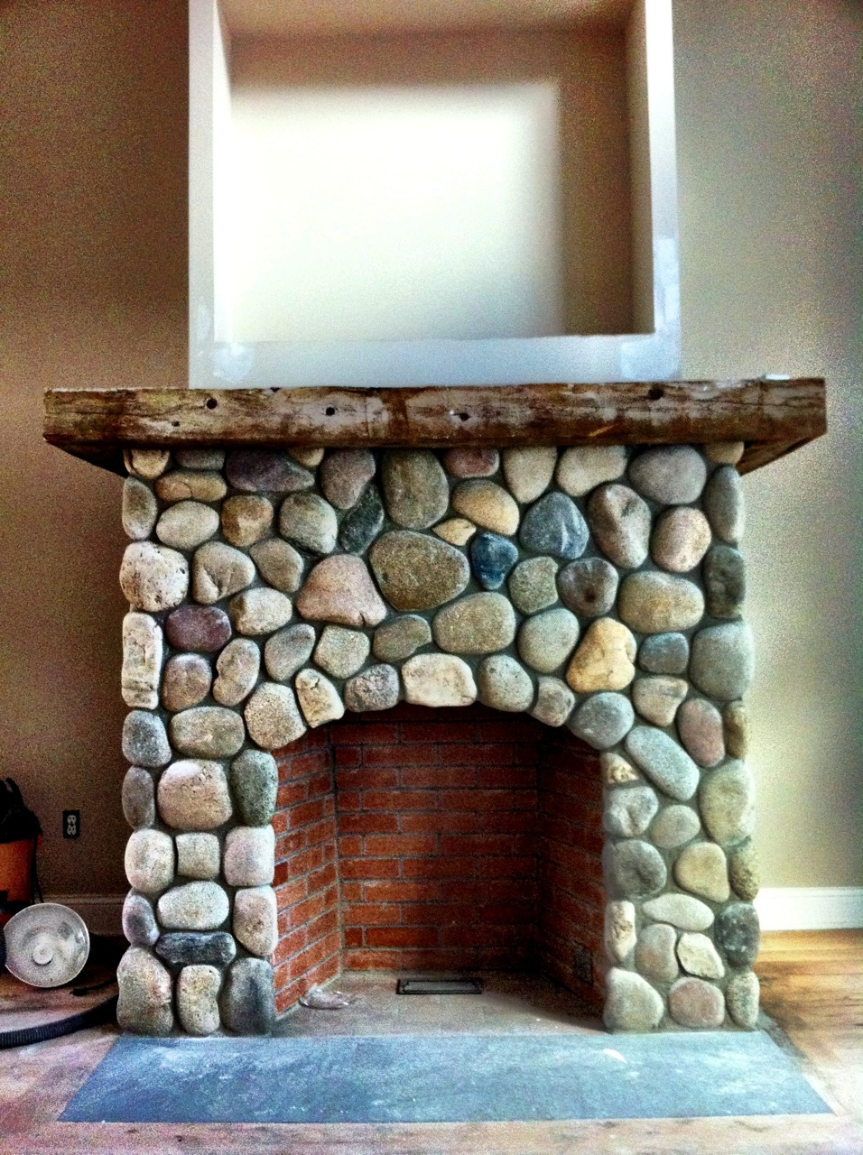River Stone Veneer Fireplace